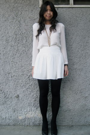 A black-and-white mini dress looks especially flattering with black tights and platform heels.
