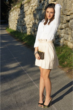 Discover this look wearing White Camiceria Baldini Shirts, Dark Brown Fendi Bags, Peach Betty Blue Skirts...